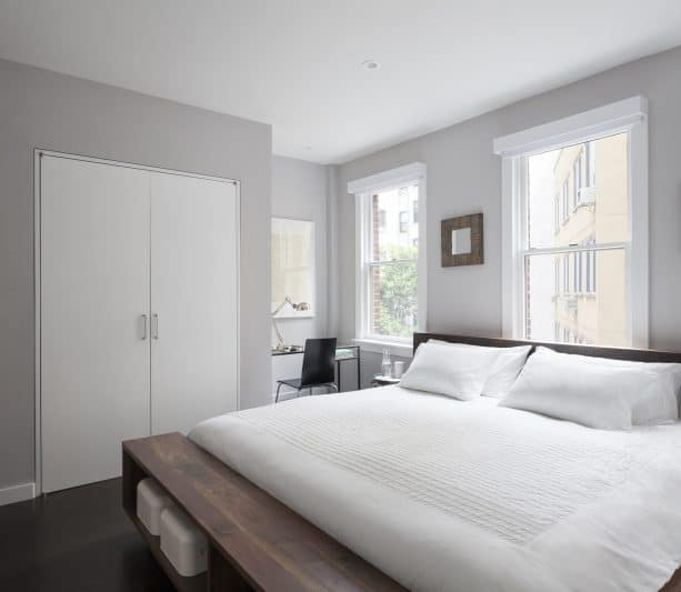 grey and white bedroom with coffee brown wooden bed