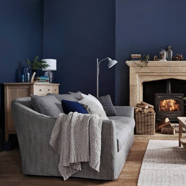traditional grey and blue living room with indigo wall