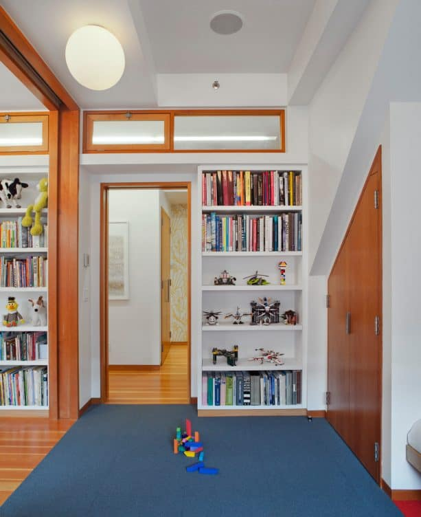a kids room with transom windows in the wall design
