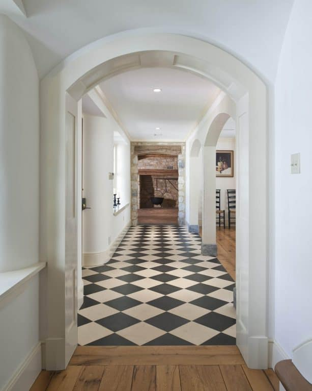 the combination between black and white checkered marble floor and hardwood