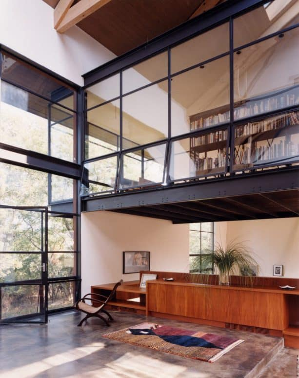 contemporary home office and library with interior windows with opening