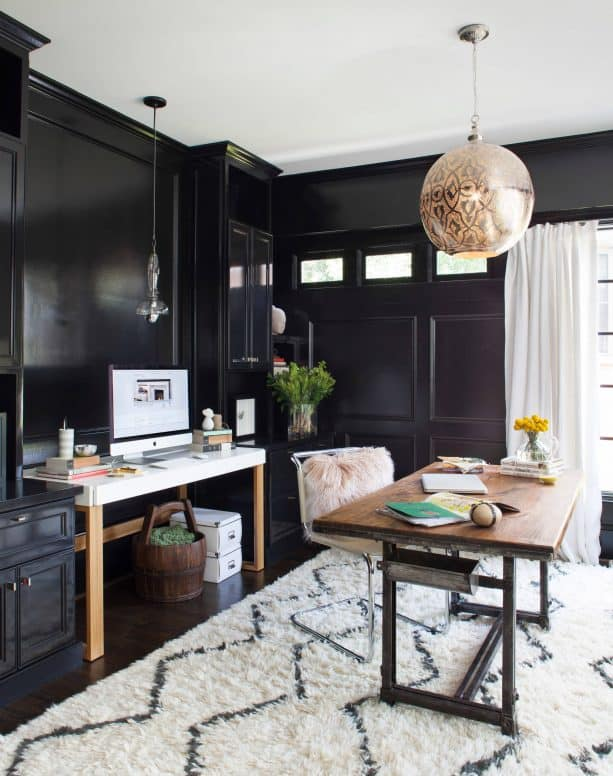 transitional home office with black wall and trim paint color