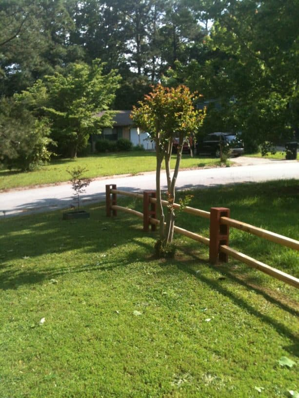 a very simple fence from cinder block and wood
