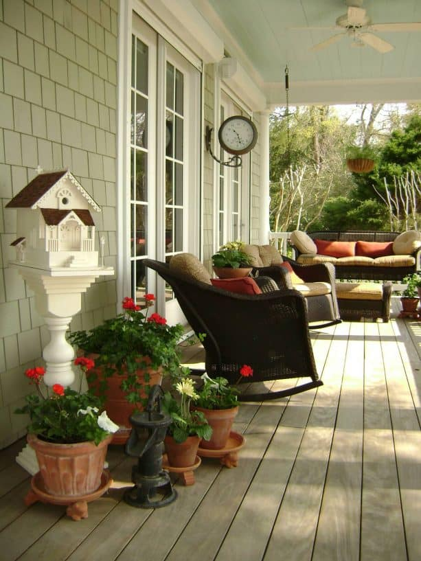 a sage porch with welcoming red decorations