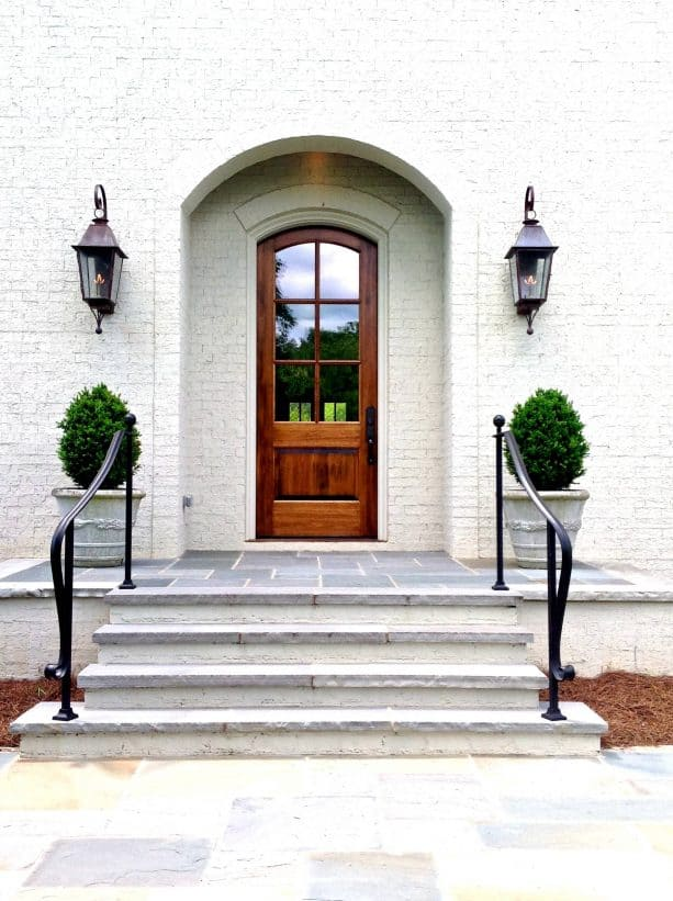 a mahogany door with antique brown stain and white trim