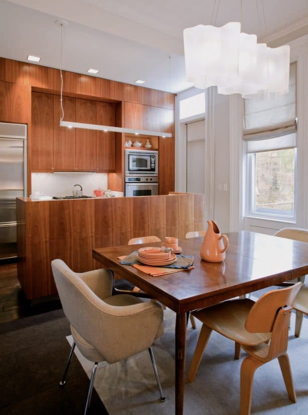 a free-standing style half wall from walnut in a contemporary kitchen and dining area