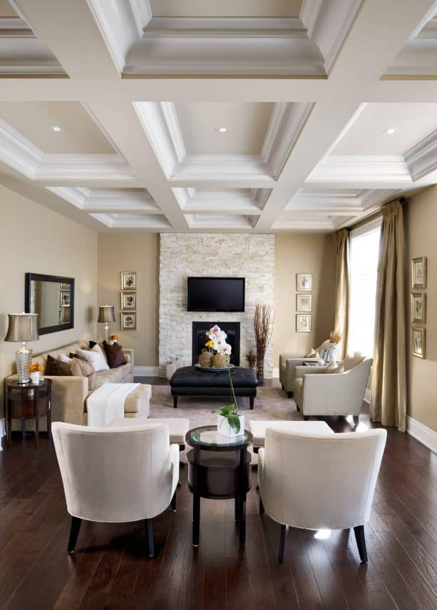 a traditional living room with tan and white color scheme