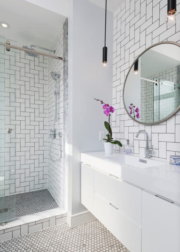 unique diagonal herringbone white subway tile wall with Timberwolf grout