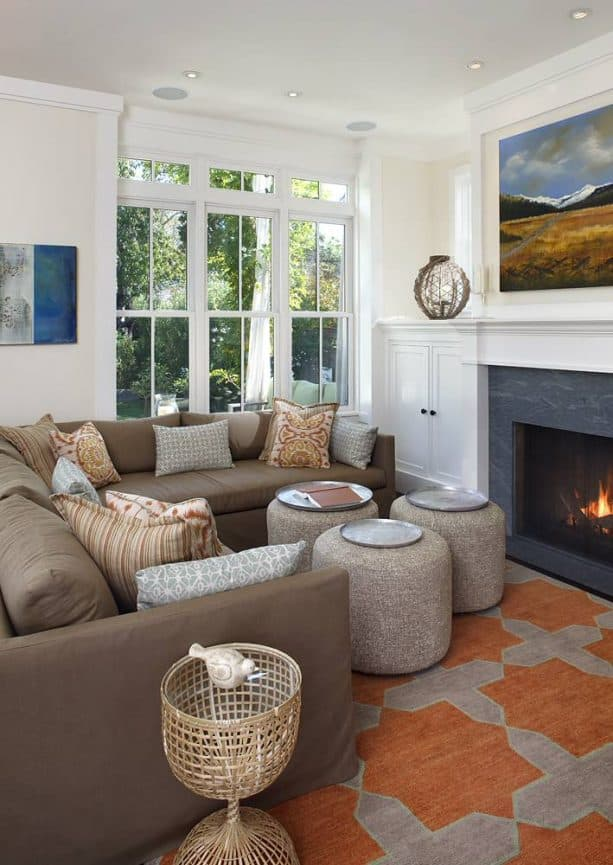small traditional living room with sectional coffee brown sofa with light gray pillows