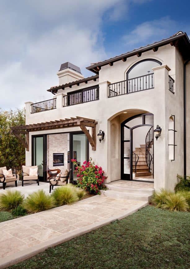the use of chiffon white stucco and bronze trim in a Mediterranean exterior