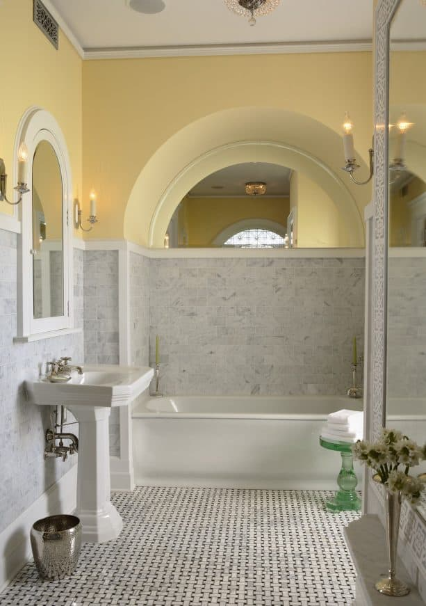 a traditional bathroom with two-toned wall design