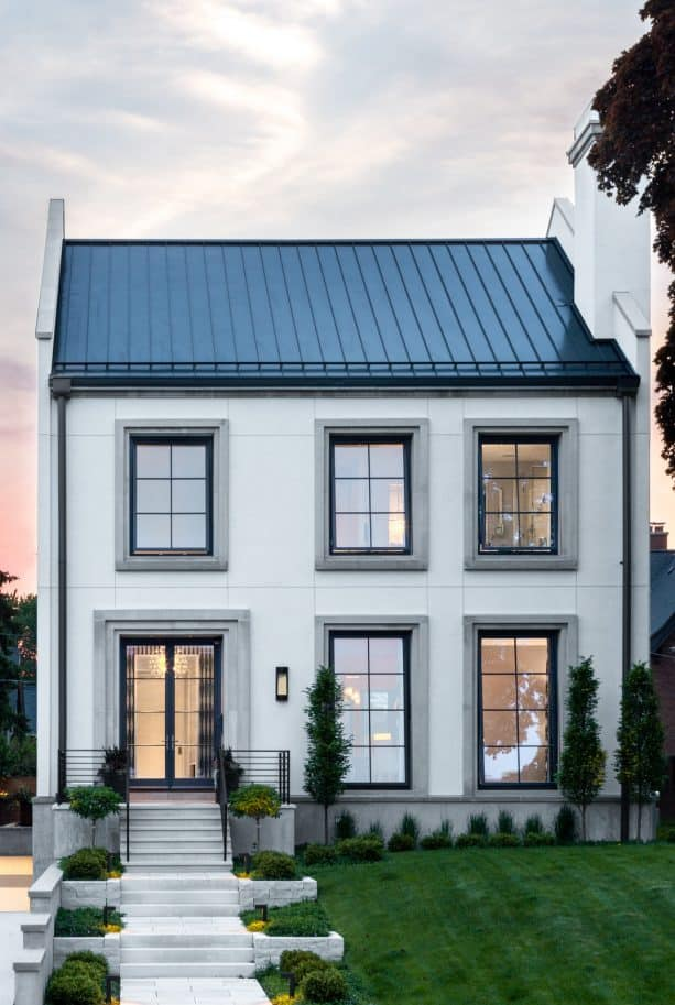 a contemporary two-story house with white stucco wall and grey trim