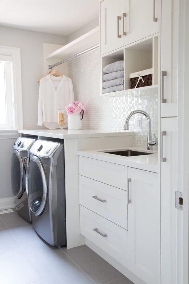 small laundry room with white color domination