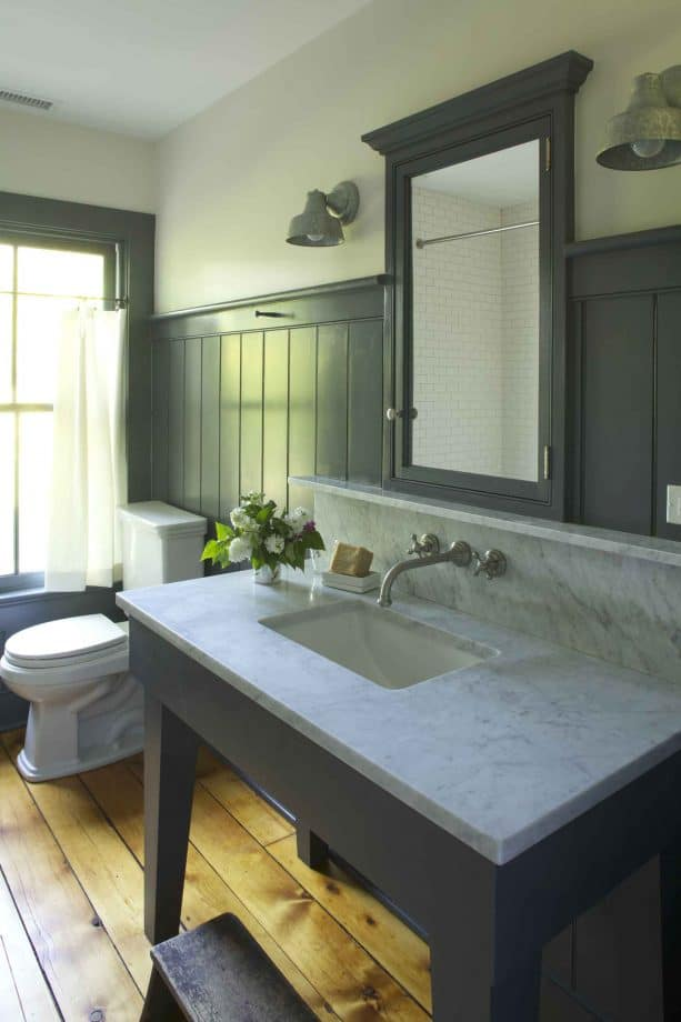 bathroom with grey beadboard walls and heart pine wood floor with clear finish
