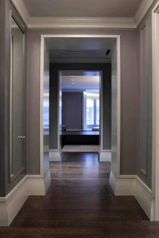 contemporary hall with dark grey wall and stained white oak floor