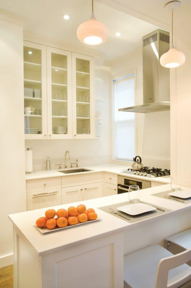 white shaker cabinets paired with kitchen peninsula for a small open kitchen