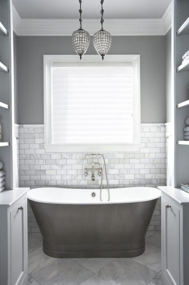 grey and white bathroom with gray tub
