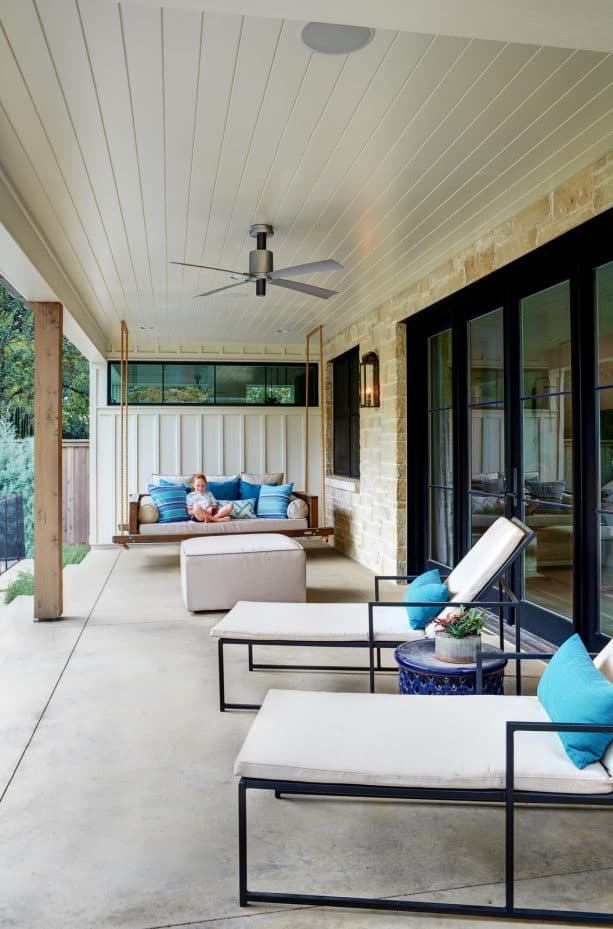 a transitional porch ceiling from white painted tongue and groove material