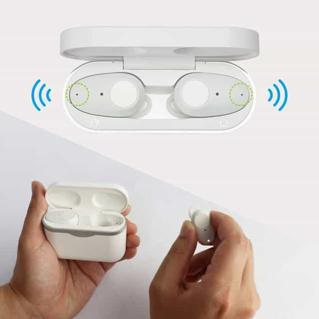 Image shows the earbuds in the charging case.
