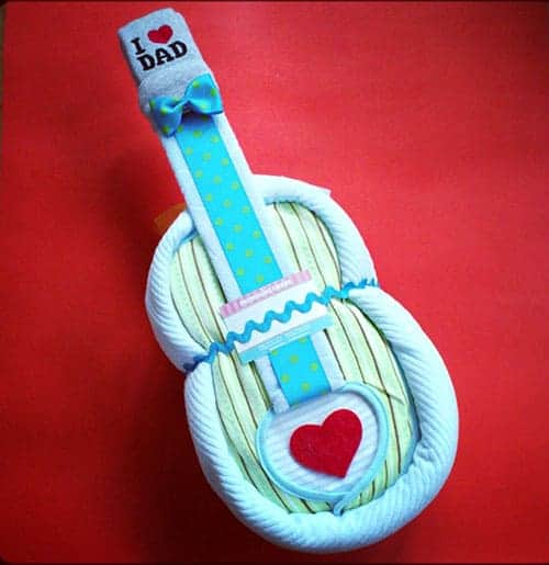 Guitar Diaper Cake. 15 Creative Diaper Cakes. Amazing Baby Shower Party Ideas, crafts and homemade gifts.