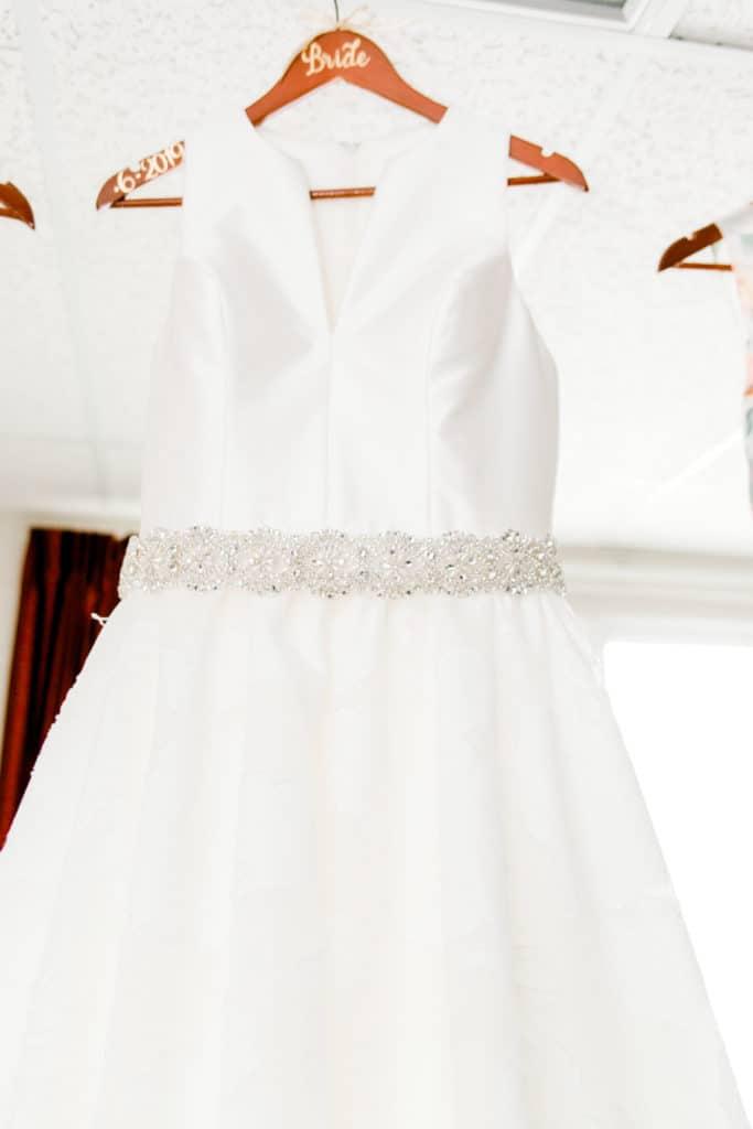 wedding dress hanging on the hanger