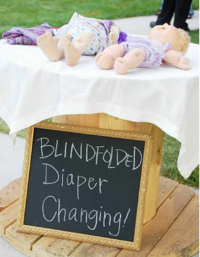 DIAPER THE BABY-BLINDFOLDED! - Refreshing baby shower game ideas, printables and more so you can plan the best baby shower! Baby shower games for women, men and couples.