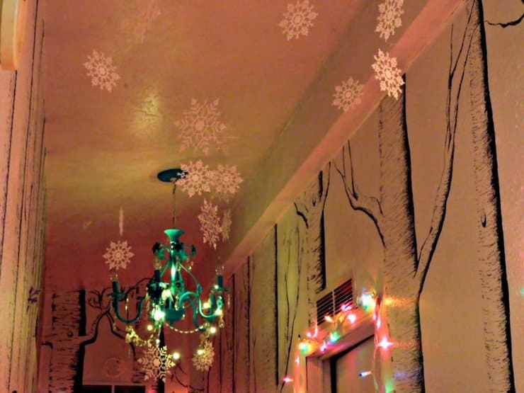 snowflake ornaments hanging from the ceiling
