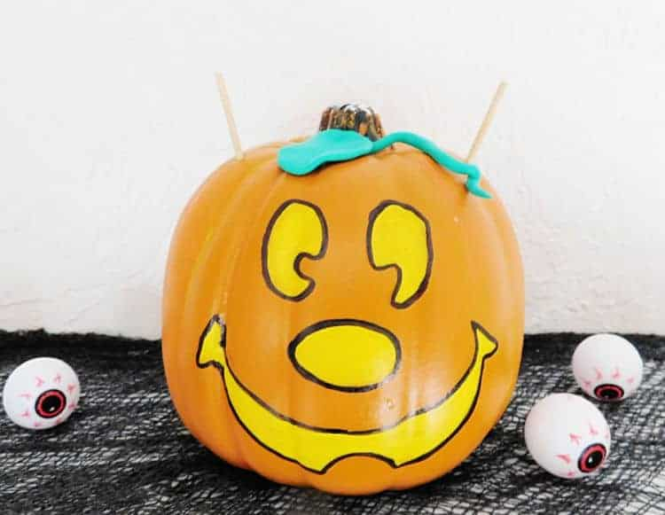 mickey pumpkin with bamboo skewers coming out of each side
