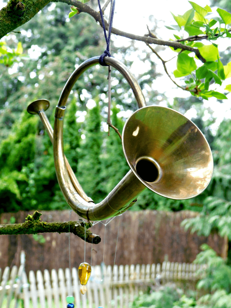 horn hanging from tree with beads and and fishing line