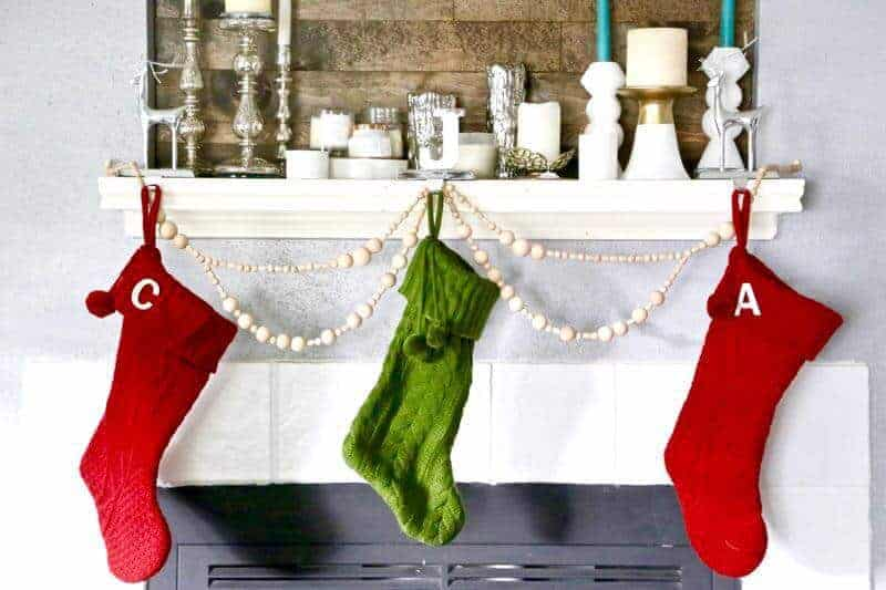 beaded garland with stockings hung on a mantle