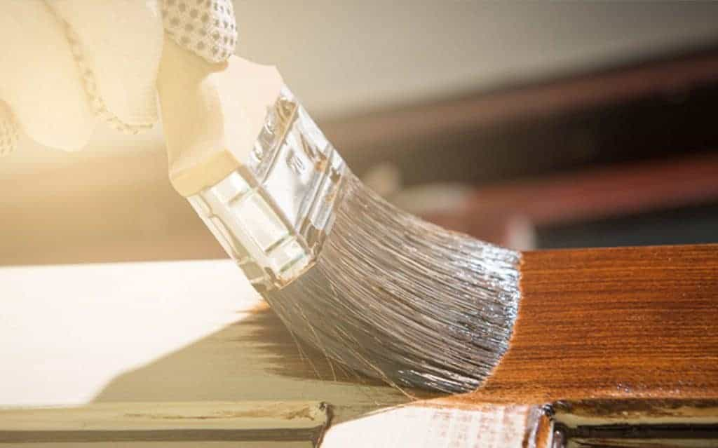 industrial coating being applied by brush