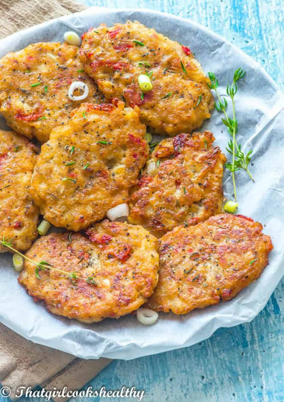 seven fritters on a plate