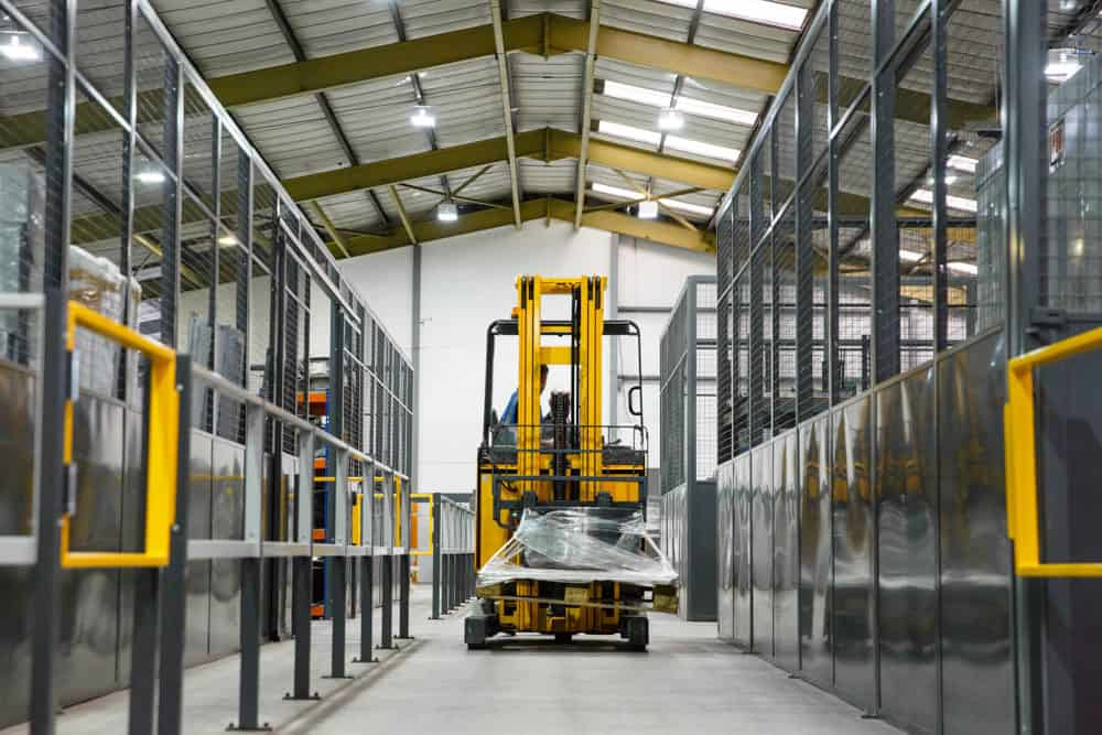 Commercial and manufacturing photo of a folk lift truck in a warehouse image used for branding