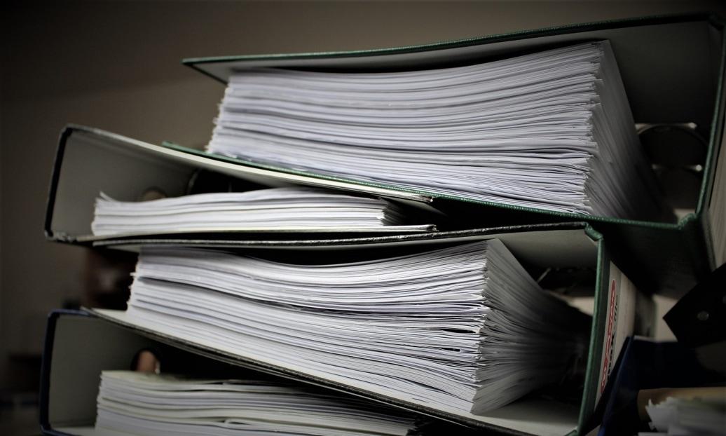Stacked folders of employee policies