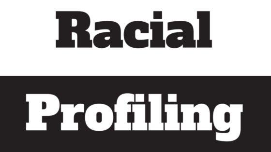 Black and white image says racial profiling