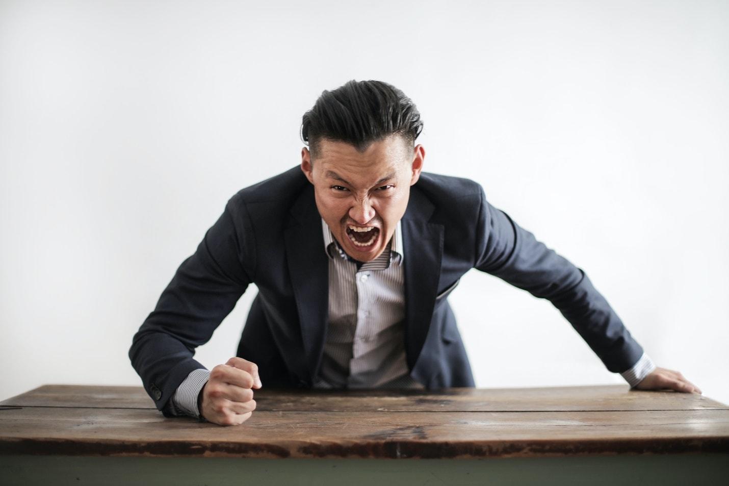 Man in suit screaming