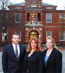 family law attorney team picture in front of the courthouse in Annapolis MD