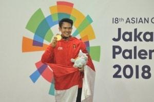 Komang Harik Adi Putra won gold at final round in a pencak silat competition held at Padepokan Pencak Silat, Taman Mini Indonesia Indah (TMII), Jakarta, Monday (27/8). (Foto: PR/Jay).
