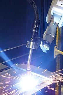Image of live welding with a TOUGH GUN CA3 robotic MIG gun