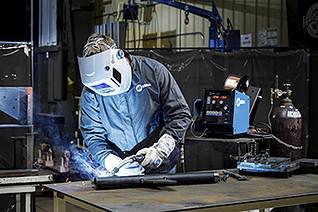 Image of welder with semi-automatic MIG gun welding