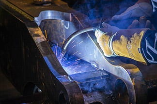 Image of live welding with semi-auto MIG gun