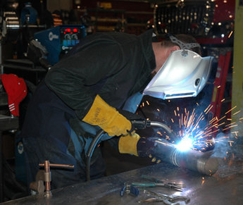 Image of a person welding in a welding shop