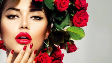 Model with roses in hair wearing natural lipstick