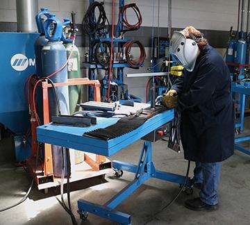 Man welding showing proper ergonomics