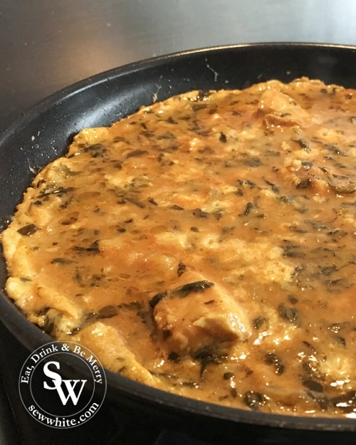 left over indian takeaway curry omelette being cooked on the hob