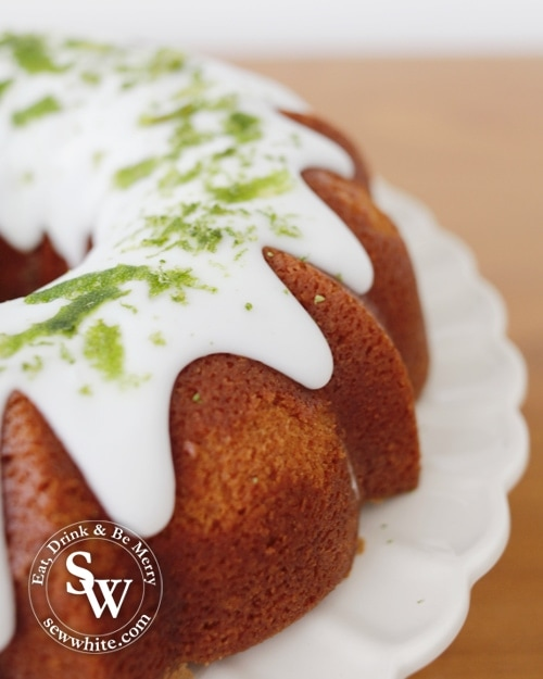 Daiquiri bundt Cake  with zest of lime on top of the white icing