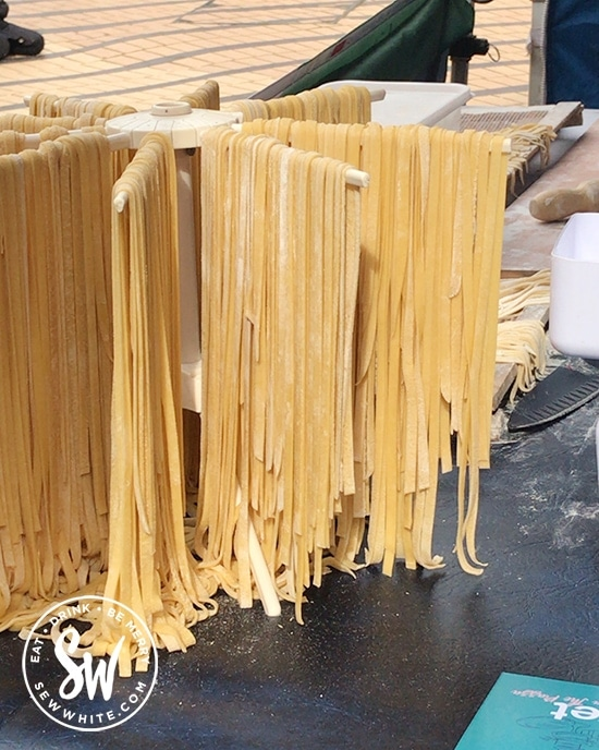 Fresh pasta drying on a stand