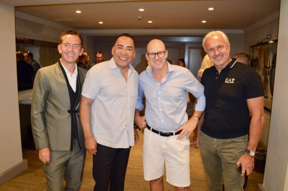 Tim Storey posing for a photo with people attending the seminar