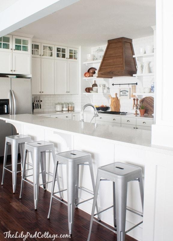 White Kitchen with wood range hood