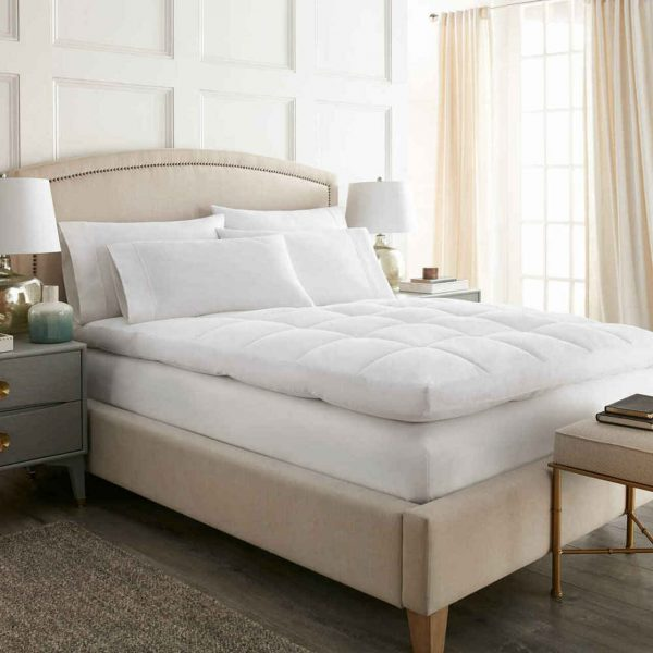 an ultra plush featherbed with a quilted top